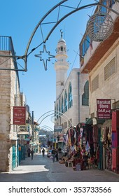 BETHLEHEM, ISRAEL - MARCH 6, 2015: The aisle in the Town with the minaret in background.