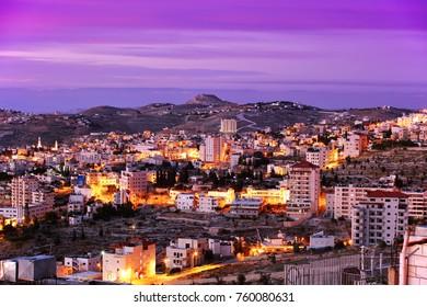 "BETHLEHEM, ISRAEL - MAY 16, 2014: A beautiful sunrise in Bethlehem city in Palestine. Panoramic view from the hotel ""Bethlehem inn"""