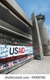 BETHLEHEM, OCCUPIED PALESTINIAN TERRITORIES - JULY 28: Activist graffiti adorns the Israeli separation wall in the West Bank town of Bethlehem on July 28, 2010.