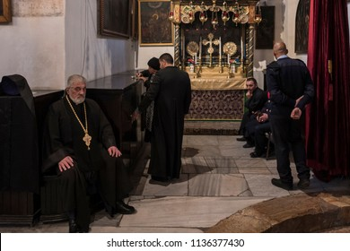 Bethlehem, Palestine - December 24 2017: The clergy is preparing the Christmas Mass in the Church of the Nativity on Christmas Eve.
