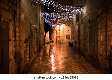 Bethlehem, Palestine - December 24 2017: The street view of Bethlehem with Christmas lighting at rainy night on Christmas Eve.