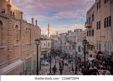 Bethlehem, Palestine - December 24 2017: The street view of Bethlehem with decorations at sunset on Christmas Eve.
