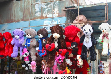 BETHLEHEM, PALESTINE - February 14, 2019. Market store sells different kinds of teddy bears, huge dolls, puppets and Valentine hearts in the souk.