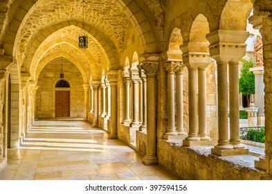 BETHLEHEM, PALESTINE - FEBRUARY 18, 2016: The inner courtyard of the Church of the Nativity is surrounded by beautiful covered terraces with stone columns, on February 18 in Bethlehem.