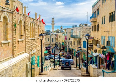 BETHLEHEM, PALESTINE - FEBRUARY 18, 2016: The narrow Pope Paul IV street is the central street of the city, on February 18 in Bethlehem.