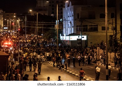 Bethlehem, Palestine, July 23, 2014: Crowds of Palestinian demonstrators on the street in front of the separation wall in Bethlehem during night riots against Israel.