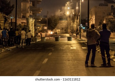 Bethlehem, Palestine, July 23, 2014: Palestinians on the street in front of the separation wall in Bethlehem during night riots against Israel.