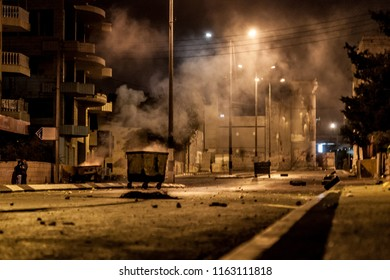 Bethlehem, Palestine, July 23, 2014: Smoke is hanging over a street in front of the separation wall in Bethlehem during the night riots against Israel.