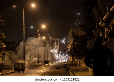 Bethlehem, Palestine, July 23, 2014: Palestinians shoot fireworks at the separation wall in Bethlehem during night riots against Israel.