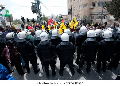BETHLEHEM, PALESTINIAN TERRITORIES - MARCH 30: Palestinian activists confront Palestinian Authority riot police blocking access to the Bethlehem checkpoint during Land Day protesters on March 30, 2012