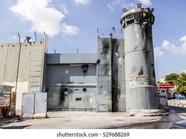 BETHLEHEM, WEST BANK PALESTINE - JUNE 09, 2016. Israeli West Bank separation barrier wall clear of graffiti. Rachel's Tomb behind the gate