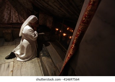 Bethlehem, West Bank, Palestinian Territories - March 06, 2008 : People gather to pray and reflect at the birthplace of Jesus inside the Church of the Nativity in Bethlehem.