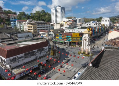Betong, THAILAND - January 29, 2016: Arial view of Betong city, Yala,Thailand. People drive a car and ride a motorbike around the clock tower.