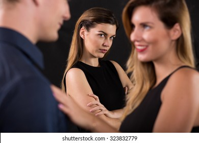 Betrayal concept - beauty woman seducing attractive man