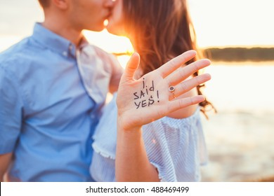 Betrothal. Proposal in the beach with a man asking marry to his happy girlfriend. Proposal concept