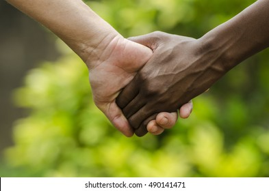 For A Better Future on Earth - Black and White Women Holding Hands Together