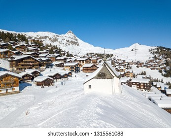 Bettmeralp, Switzerland - February 16. 2019: Aerial image of the Chapel Maria in Snow (Kapelle zum Schnee) with the Swiss alps village Bettmeralp in Canton Vaud. It is a famous winter sport resort.