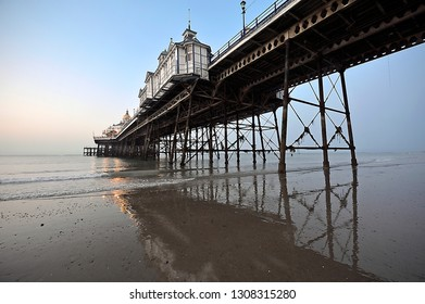 Between the Grand Parade and Marine Parade in East Sussex, England.July 28th 2011.   Sunrise over Eastbourne pier in July 2011 before the fire, later found to be an arson attack of 2014