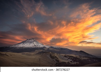 Between Ice and Fire. Sunset over Popocatepetl volcano, view from Iztaccihuatl volcano.