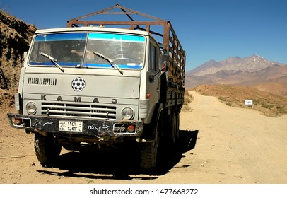 Between Kabul and Bamyan (Bamiyan) / Afghanistan - Aug 18 2005: A Kamaz truck on a dusty road, the southern route from Kabul to Bamyan (Bamiyan). Kamaz truck, dirt road, transport, Central Afghanistan
