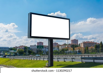 Between two ways billboard canvas mockup in city and blue sky background. Beautiful weather