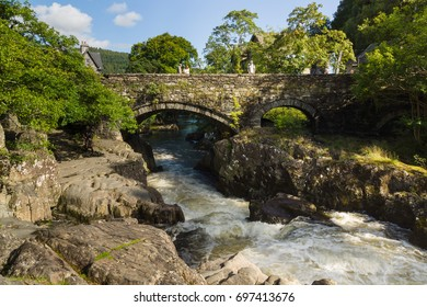 Betws y Coed Wales UK - August 15 2017: The Pont y Pair or Bridge of the Cauldron over the River Llugwy dated from 1475 and is the oldest existing crossing point in the village