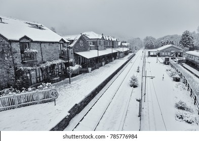 Betws-y-Coed railway station. A small historic passenger station on the Conwy Valley Line which runs from Llandudno Junction to Blaenau Ffestiniog, Wales, UK. A snow covered winter scene at Christmas.