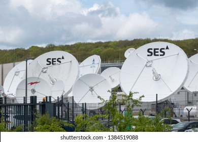 Betzdorf / Luxembourg - 04 26 2019: Satellite dishes outside the SES headquarters in Luxembourg. SES S.A. is a communications satellite owner and operator.