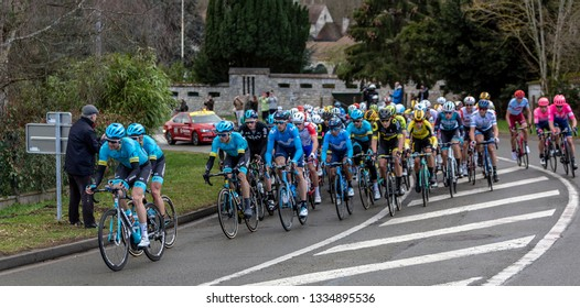 Beulle, France - March 10, 2019: The peloton riding on Cote de Beulle during the stage 1 of Paris-Nice 2019.