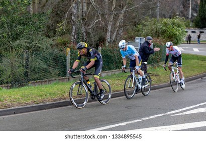 Beulle, France - March 10, 2019: The breakaway (Damien Gaudin ,Evaldas Siskevicius , Warren Barguil ) riding in front of the race on Cote de Beulle during the stage 1 of Paris Nice 2019