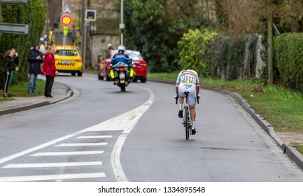 Beulle, France - March 10, 2019: Rear view of the Romanian cyclist Eduard Grosu of Delko Marseille Provence Team riding on Cote de Beulle during the stage 1 of Paris-Nice 2019.