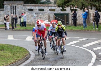 Beulle, France - March 10, 2019: Group of cyclists (Jack Baue, Bert Van Lerberghe, Fabio Aru) riding on Cote de Beulle during the stage 1 of Paris-Nice 2019.