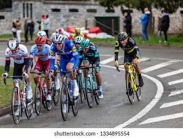 Beulle, France - March 10, 2019: The Belgian cyclist Tim Declercq of  Deceuninck-Quick Step Team riding in the peloton on Cote de Beulle during the stage 1 of Paris-Nice 2019.