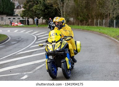 Beulle, France - March 10, 2019: The Yellow Bike of LCL driving on Cote de Beulle during the stage 1 of Paris-Nice 2019.