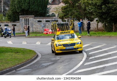 Beulle, France - March 10, 2019: The Yellow car of Mavic driving on Cote de Beulle during the stage 1 of Paris-Nice 2019.