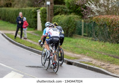 Beulle, France - March 10, 2019: Rear view of the breakaway (Damien Gaudin  ,Evaldas Siskevicius, Warren Barguil )  riding in front of the race on Cote de Beulle during the stage 1 of Paris-Nice 2019