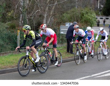 Beulle, France - March 10, 2019: Group of cyclists (Jack Bauer, Bert Van Lerberghe , Fabio Aru ) riding on Cote de Beulle during the stage 1 of Paris-Nice 2019.