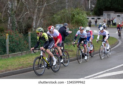 Beulle, France - March 10, 2019: Group of cyclists (Jack Bauer, Bert Van Lerberghe, Fabio Aru) riding on Cote de Beulle during the stage 1 of Paris-Nice 2019.