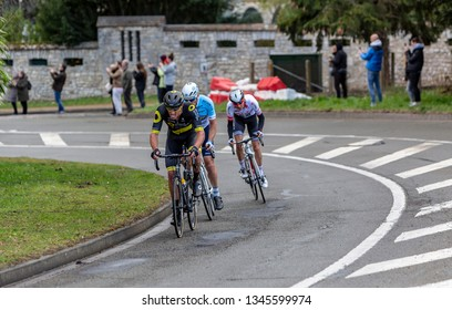 Beulle, France - March 10, 2019: The breakaway (Damien Gaudin,Evaldas Siskevicius, Warren Barguil) riding in front of the race on Cote de Beulle during the stage 1 of Paris-Nice 2019