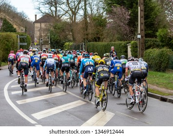Beulle, France - March 10, 2019: Rear view of the peloton riding on Cote de Beulle during the stage 1 of Paris-Nice 2019.
