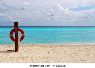 Beutiful cloudy scene - Seascape and Lifebuoy on a white sandy Caribbean beach in Cancun, Mexico