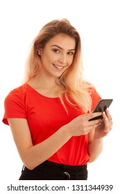 Beutiful young woman texting message on a smartphone isolated over white background