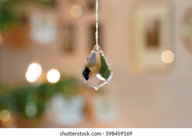 Bevelled Glass Crystal in front of Christmassy Bokeh Background