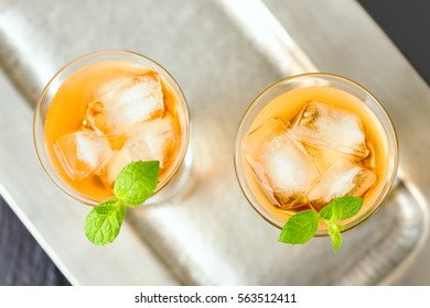 Beverage with ice cubes in glass.