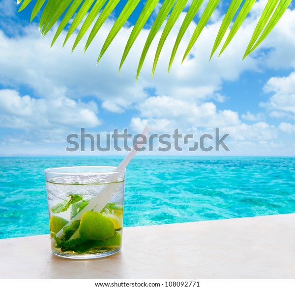 beverage mojito drik in tropical turquoise tropical sea like in paradise  [ photo-illustration]