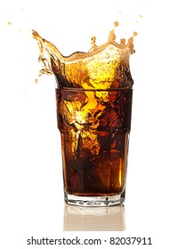 beverage splash into a glass on white background