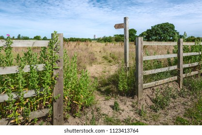 Beverley, Yorkshire, UK. Public footpath through fallow field towards ancient minster on britght summer day in Beverley, Yorkshire, UK.