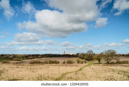 Beverley, Yorkshire, UK. View across agricultural landscape and parklands with trees and ancient minster on horizon in spring in Beverley, Yorkshire, UK.