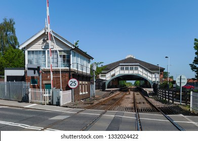 Beverley, Yorkshire, UK. View from the road crossing of the main Beverley railway station and station house on a fine spring morning in Beverley, Yorkshire, UK.