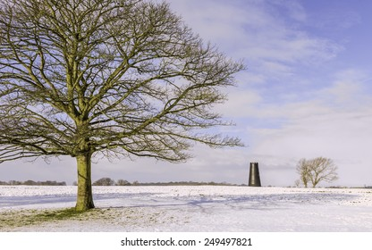 Beverley, Yorkshire, UK. Beverley Westwood on a bright winter day with a view of the Black Monument, a disused windmill, surrounded by snow in Beverley, Yorkshire, UK.